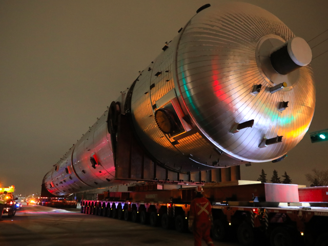 Watch Trucks Tow a Really Big Thing It's Heavier Than the Statue of Liberty