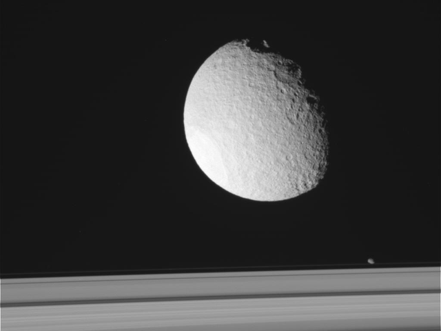 Cassini's Latest View Of Tethys,Enceladus And The Rings Of Saturn