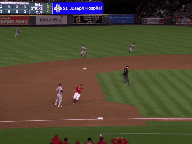 Josh Reddick Fries Mike Trout At Third, poi Cook Ian Kinsler At The Plate