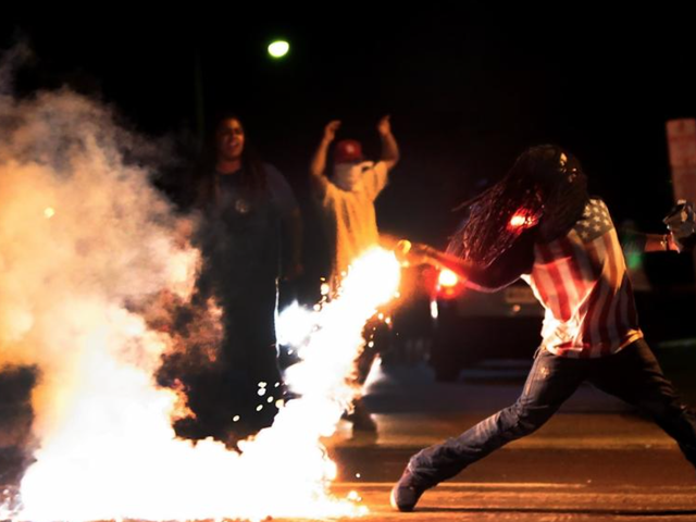 Edward Crawford: Ferguson, Mo., Activist in Iconic Photo Found Dead From Gunshot Wound