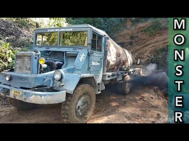 Watch an old military truck help destroy a forest.