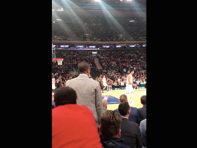 Guy At Knicks Game Unwisely Tries To Get Team Staffer To Sit Down By Tugging On His Coat