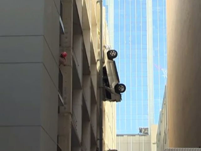 Holy Shit Watch This Car Dangle From A Parking Garage Live