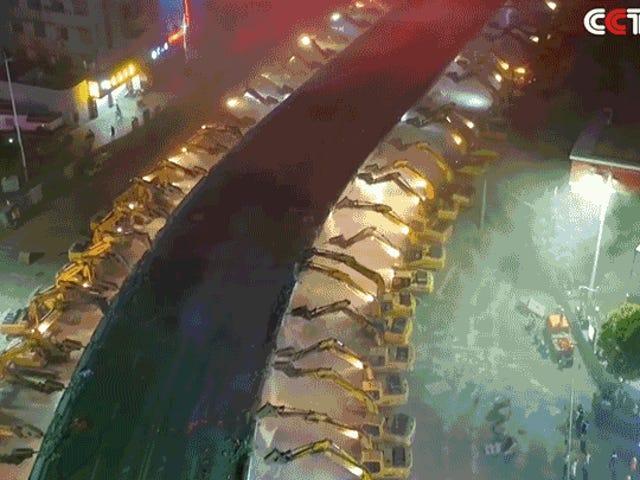Watch 116 Excavators Demolish a Massive Overpass In Just One Night