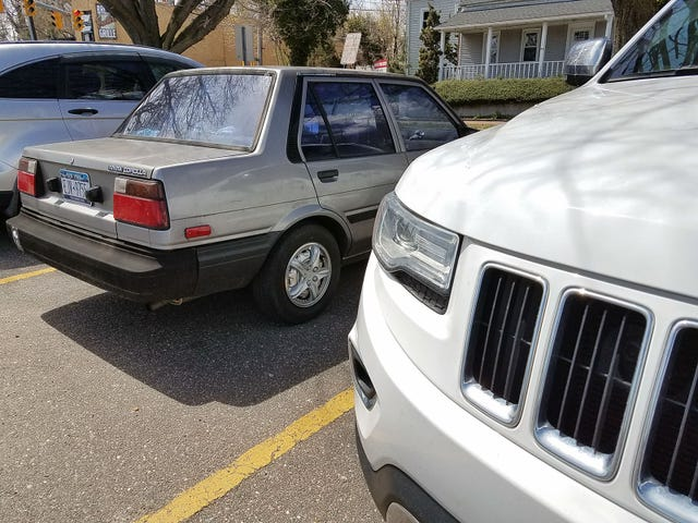 Parked next to the quintessential 80s super luxury sedan.