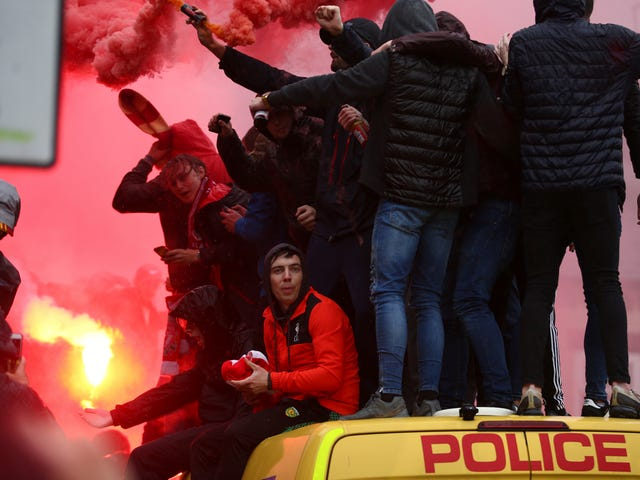 Liverpool Fans Get Rowdy, Hop On Police Vans