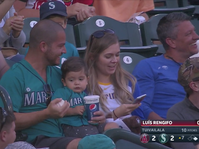 Small Child Unimpressed With Dad's One-Handed Catch And Perhaps The Sport Of Baseball