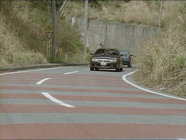 There exists a touge battle between a Nissan Skyline GTS-t...