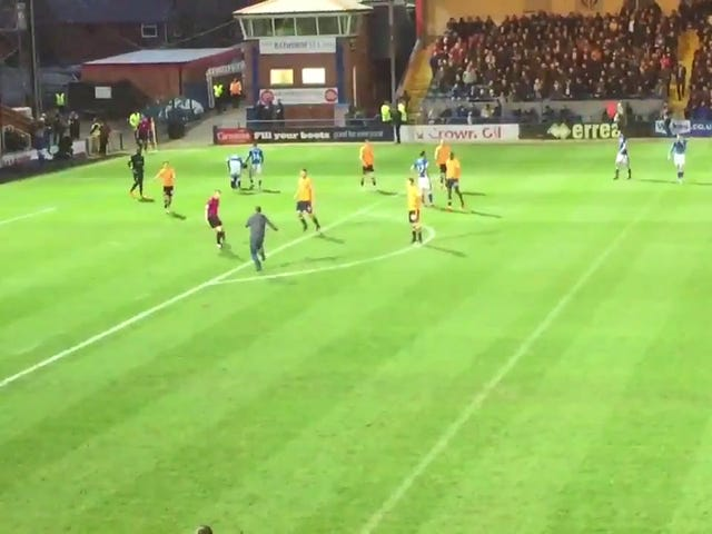 Idiot On The Pitch Tries To Tackle Ref, Fails