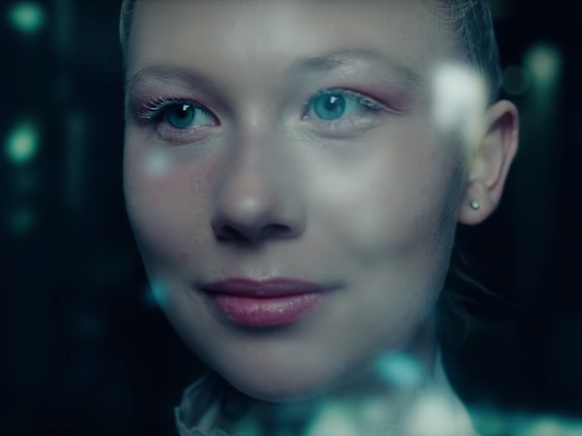 Two Refugees Digitally Disguise Themselves In This Haunting Sci-Fi Short