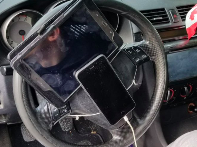 Police Stop Driver With Tablet And iPhone Attached To Steering Wheel