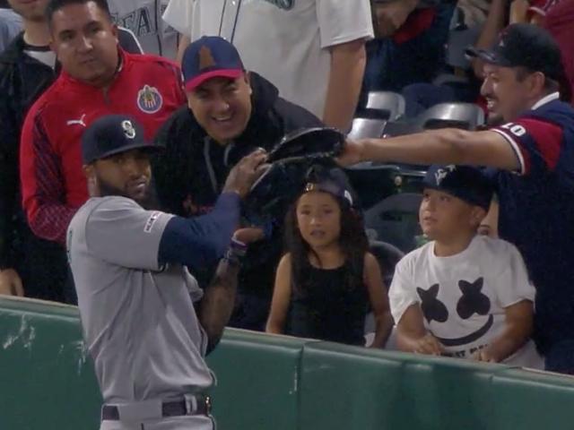 Domingo Santana Caught A Foul Ball And A Fan's Glove
