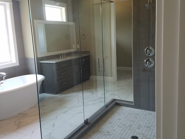 This home's master shower pan has the same square footage as my entire bathroom