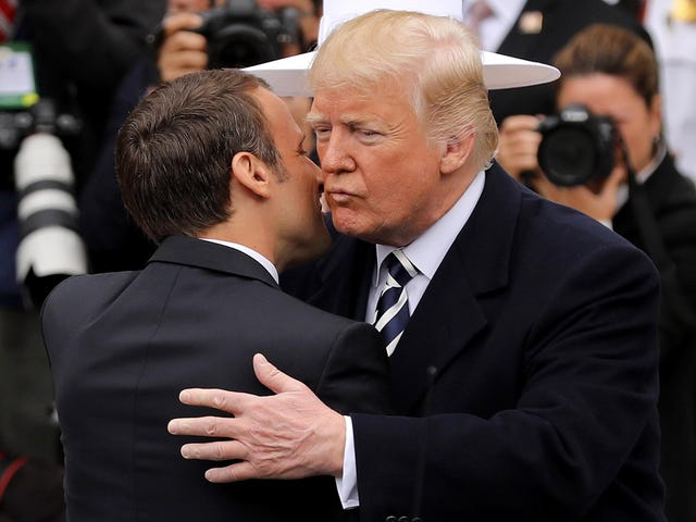 Watch: Trump Embarrasses French President by AwkwardlyWiping Dandruff off His Collar