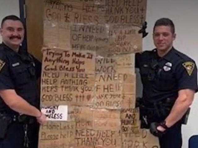 Alabama Police Poses With 'Quilt' Made from Signs of the Homeless
