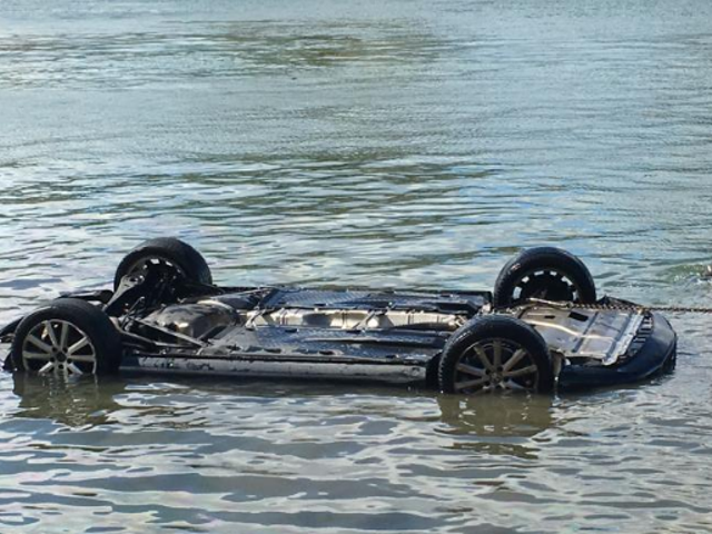 Car Plunges Into River After Spider Falls Into Teen's Lap