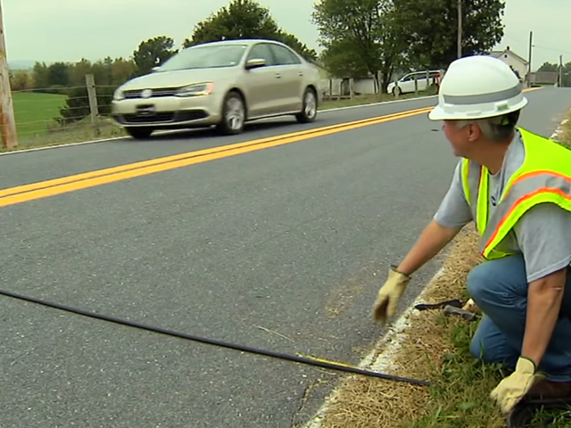 Here's What Those Weird Black Tubes In The Road Are For