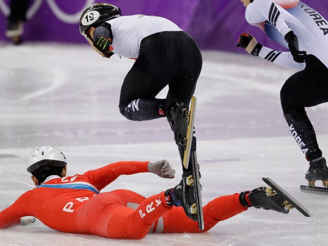 North Korean Speed Skater Appears To Trip Opponent After Falling