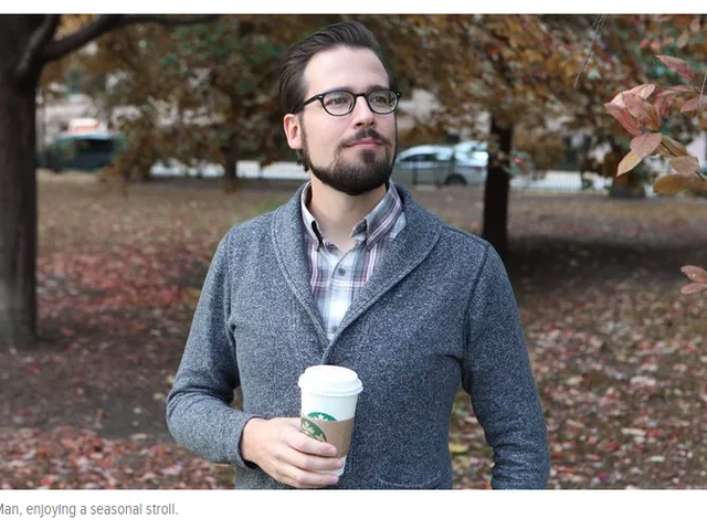The Onion-Mr. Autumn Man Walking Down Street With Cup Of Coffee, Wearing Sweater Over Plaid Collared Shirt