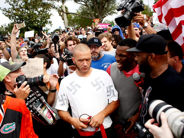 Black Protester Hugs Squirming Nazi, Quips, 'Why Don't You Like Me, Dog?'
