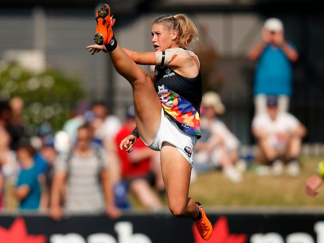 Australian Rules Footballer Receives Nasty Comments, Then Support, Over Photo Of Her Kicking