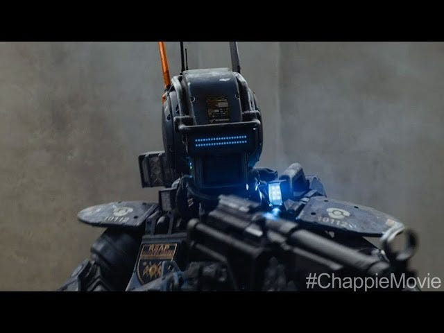 First <i>Chappie</i> Clips Vis Hugh Jackman&#39;s Hat For Sentient Robots