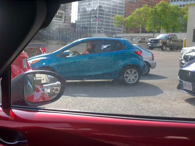 A thing rarely seen: Blue Mazda 2