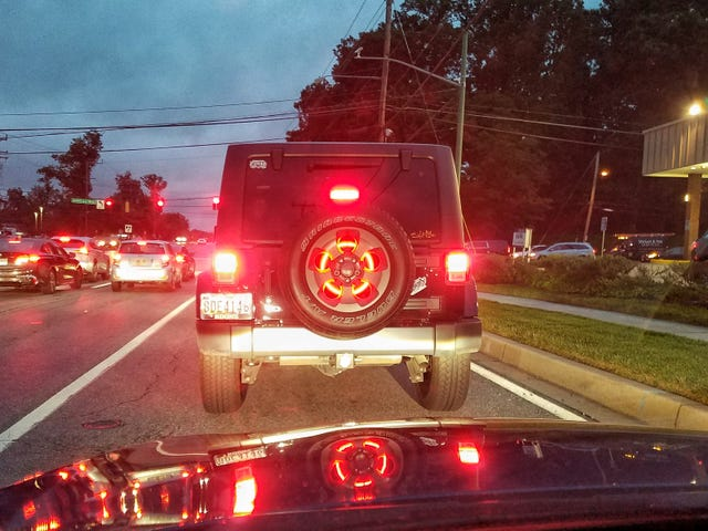 Are we allowed to like this brake light ring in a Wrangler spare tire?