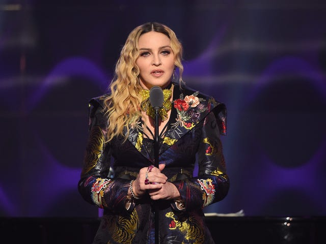 """<a href=""""https://www.avclub.com/madonna-is-going-to-direct-another-movie-1823786784"""" data-id="""""""" onClick=""""window.ga('send', 'event', 'Permalink page click', 'Permalink page click - post header', 'standard');"""">Madonna is going to direct another movie<em></em></a>"""
