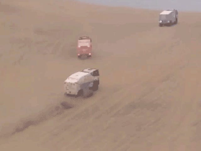 Large Trucks Thwarted By Sand Dune