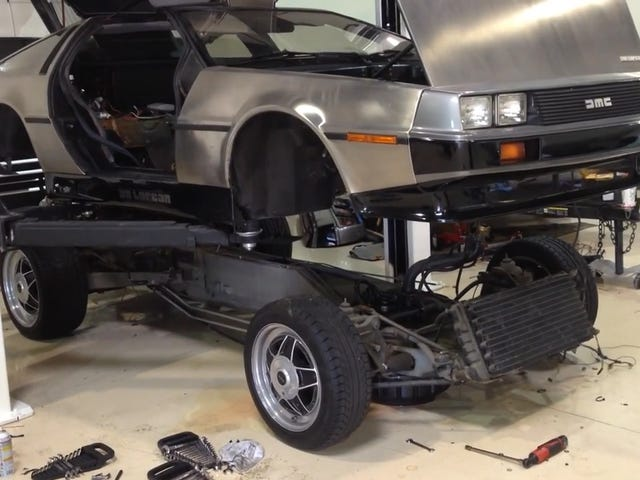This Is What It Looks Like When You Lift A DeLorean Body Off Of Its Chassis