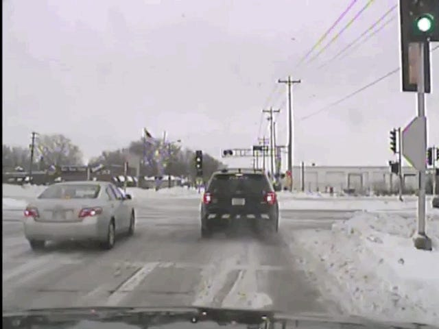 This Disappearing Cop Car Illustrates Exactly Why You Need to Slow Down in Winter