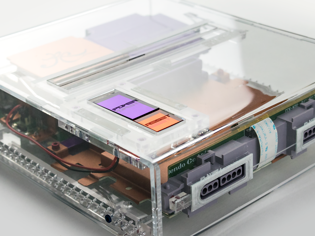 The Salvaged Guts Of Old SNES Consoles Look Great Inside These New Cases