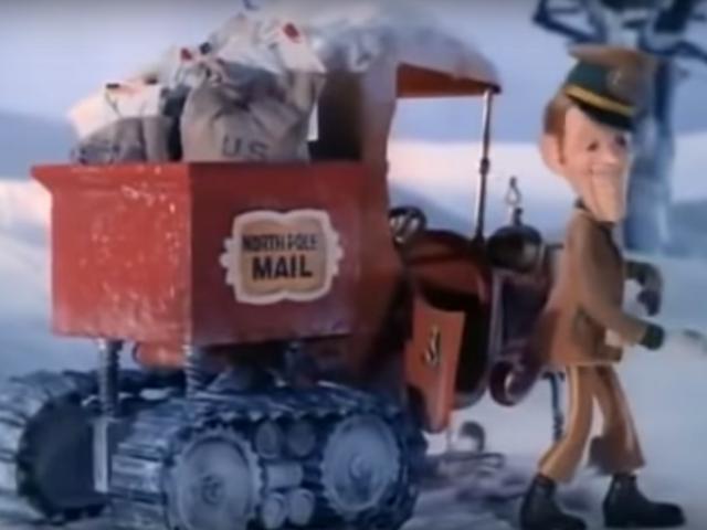 「サンタクロースは街にやってくる」の素晴らしいスノーモービルモデルTは本当のものです