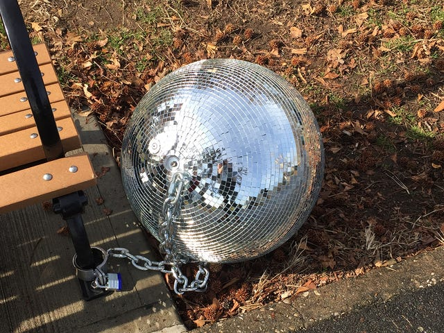 All I Had to Do to Hear Katy Perry's New Song Was Plug My Headphones Into a Disco Ball Chained to a Bench