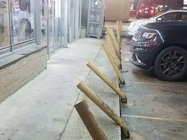 What if I told you that these bent parking bollards were spotted at a liquor store