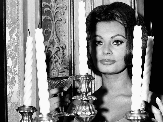Pure Glamour Is Sophia Loren Toasting You From Behind This Terrifying Candelabra