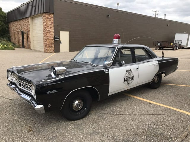 It's got a cop motor, a 440 cubic inch plant, it's got cop tires, cop suspensions, cop shocks.
