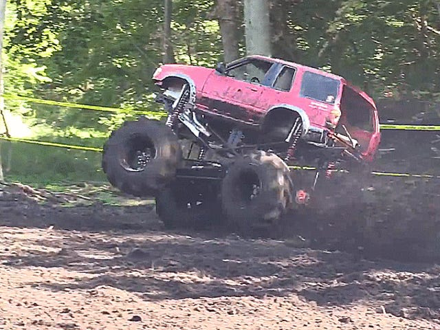 Massive Mud Truck Channels Its Inner Cat To Land On Its Feet
