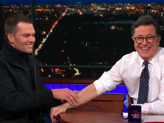 On The Late Show, Stephen Colbert tempts Tom Brady with strawberries, lotion, and a forbidden beer