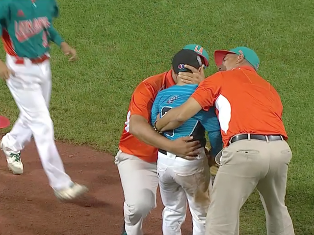Opposing Coaches And Players Console Little League Pitcher After Walk-Off