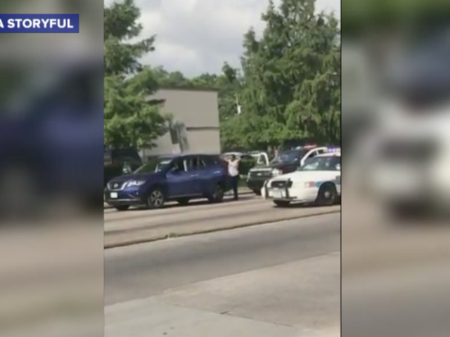 Houston Cop to Woman During Traffic Stop: 'Put Your Hands Up ... Pretend Like We're Going to Shoot You'