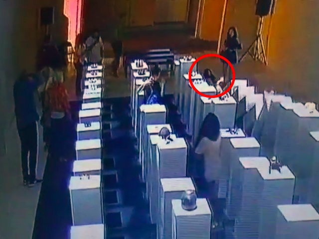 Watch a Woman Destroy $200,000 Worth of Art While Taking a Selfie