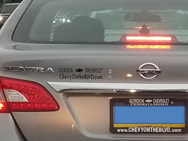 A single dealership advert on a car is one thing