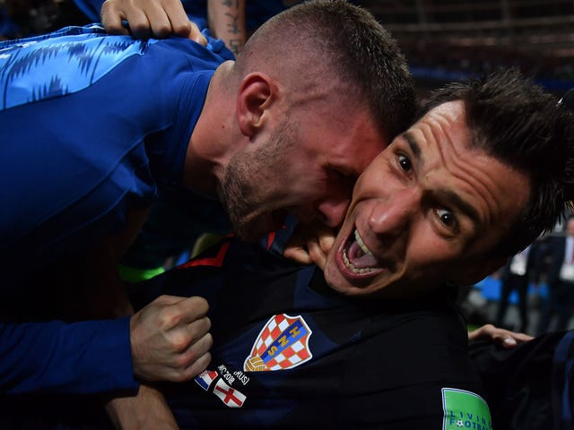 Photographer Tackled By Celebrating Croatian Players Got Incredible Photos, Kisses