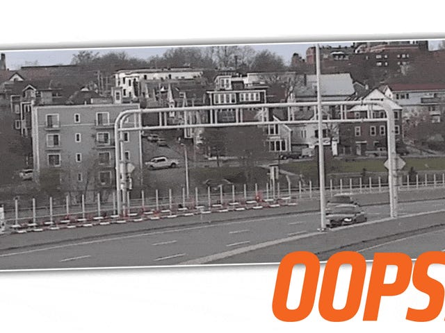 Watch An Audi Driver Smash Right Into A Bridge Traffic Gate And Remind Yourself To Never Be That Dumb