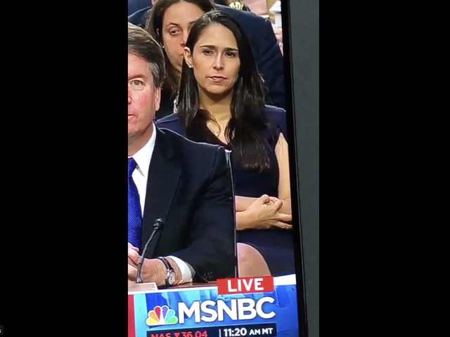 Did a Woman Sitting Behind Kavanaugh Flash the White Power Symbol During His Hearing?