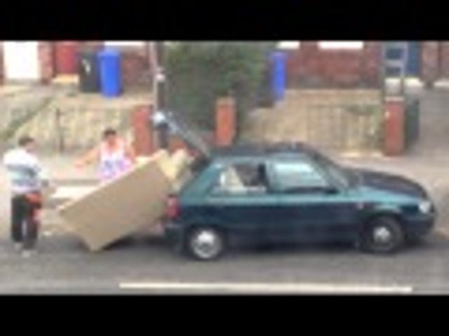 Watch These Fools Try To Shove A Gigantic Sofa Into A Very Tiny Car