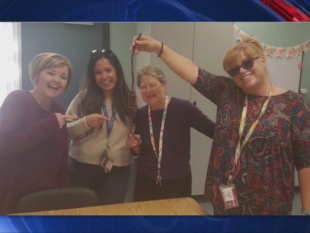 Photos Surface of Teachers at a California School Laughing and Smiling With a Noose in Hand