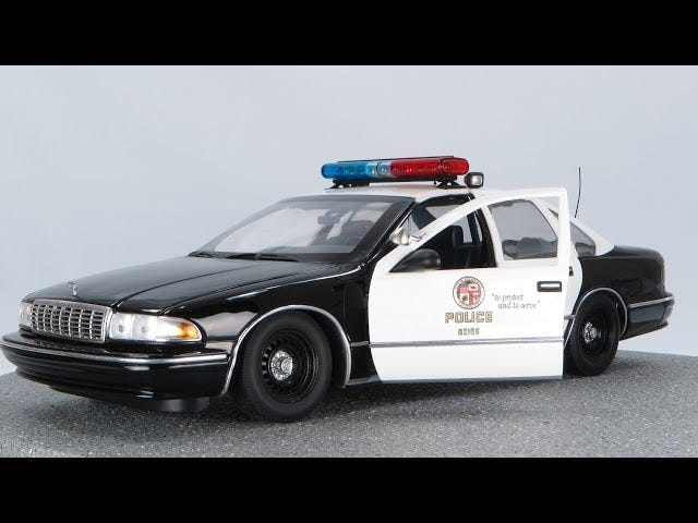 Oh no it's the 5 O..UT Models LAPD Police Car 1:18 Scale